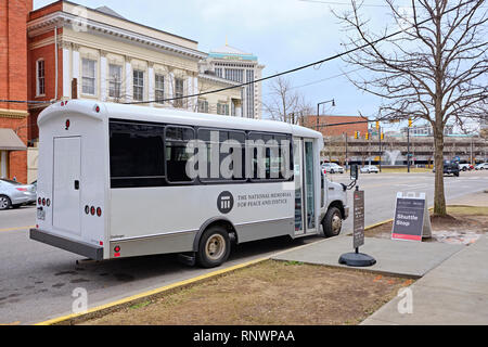 Small passenger tour bus for The National Memorial for Peace and Justice a civil rights organization in Montgomery Alabama, USA. - Stock Image