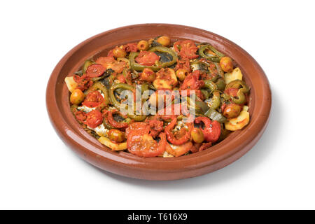 Traditional  Moroccan Tagine with sardines and vegetables isolated on white background - Stock Image
