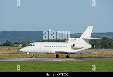 A Dassault 900ex business tri engined Jet arrives at iNVERNESS airport in the Scottish Highlands. - Stock Image