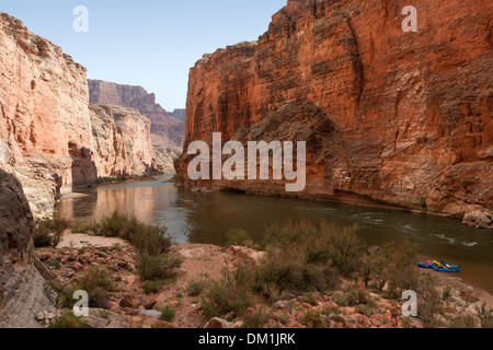 A few rafts tied to shore in the Redwall area of the Grand Canyon. - Stock Image