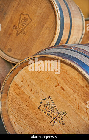 Wooden wine barrels labelled Cave Tain , Ardeche, Rhone Apls,France - Stock Image