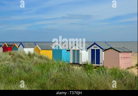 Rows of beach huts at Southwold seaside resort in Suffolk, UK - Stock Image