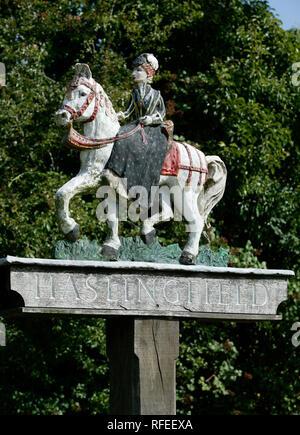 Haskingfield painted village sign with lady riding horse side saddle - Stock Image