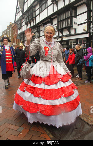 Rochester, Kent, UK. 1st December 2018: A lady dressed as a charachter from the Dickensian Age particiapte in the Man parade on Rochester High Street. Hundreds of people attended the Dickensian Festival in Rochester on 1 December 2018. The festival's main parade has participants in Victorian period costume from the Dickensian age. The town and area was the setting of many of Charles Dickens novels and is the setting to two annual festivals in his honor. Photos: David Mbiyu/ Alamy Live News - Stock Image