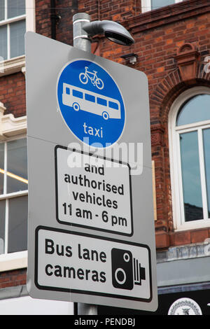 Steet sign indicating allowed and prohibited vehicles during certain hours and presence of bus lane cameras Preston Lancashire June 2018 - Stock Image