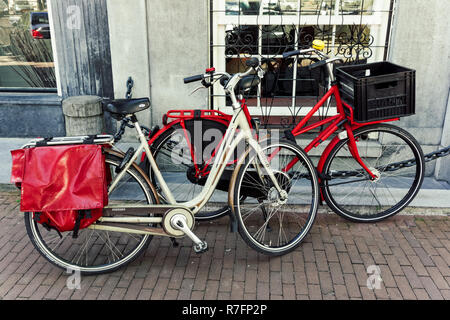 Dutch bicycles parked in Amsterdam, Netherlands - Stock Image