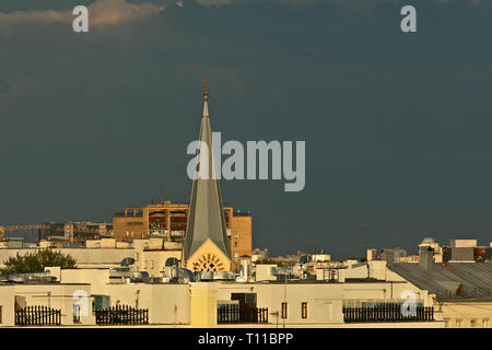 MOSCOW, AUGUST 7, 2018: Spire of the Evangelical-Lutheran St. Peter and Paul's Cathedral of Moscow at summer sunset. The cathedral is famous also for  - Stock Image