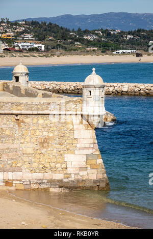 The Turrets And Walls Of Forte da Ponta da Bandeira Lagos Portugal Guarding The Harbour - Stock Image