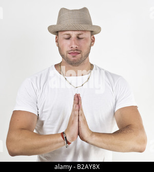 man worshipping on isolated background - Stock Image