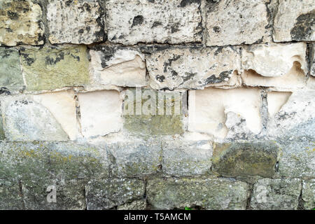Erosion of stone blocks in a wall - Stock Image