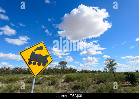 Warning train road sign on the Carnarvon Highway in Queensland interior, QLD, Australia - Stock Image