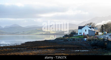Carbost on Loch Harport with the Cuillin Hills in the background, Isle of Skye, Highland Region, Scotland, UK - Stock Image