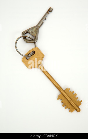 Keys on a ring isolated with white - Stock Image