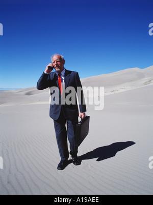 Businessman in Desert - Stock Image