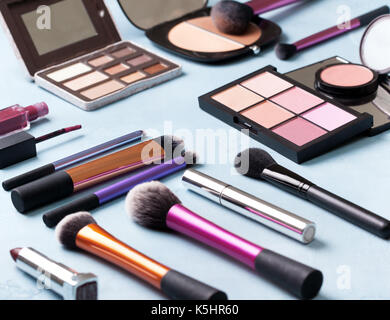 different cosmetics products on a blue background. toning - Stock Image
