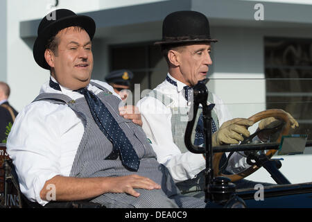 Chichester, West Sussex, UK. 14th Sep, 2013. Goodwood Revival. Goodwood Racing Circuit, West Sussex - Saturday 14th September. Actors portraying Laurel and Hardy drive a vintage car around the inside. Credit:  MeonStock/Alamy Live News - Stock Image