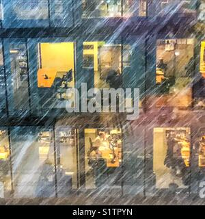 Winter office building with Snow storm - Stock Image