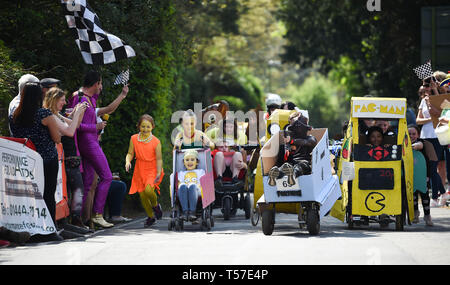 Bolney Sussex, UK. 22nd Apr, 2019. Competitors in the children's race take part in the annual Bolney Pram Race in hot sunny weather . The annual races start and finish at the Eight Bells Pub in the village every Easter Bank Holiday Monday Credit: Simon Dack/Alamy Live News - Stock Image