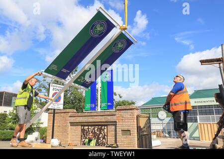 Wimbledon London, UK. 20th June, 2019. Banners with the names of Wimbledon 2018 Men's and Ladies singles champions Novak Djokovic (Serbia) and Angelique Kerber (Germany) are lifted from a truck on the gates of the AELTC which prepares to host the Wimbledon Championships Credit: amer ghazzal/Alamy Live News - Stock Image