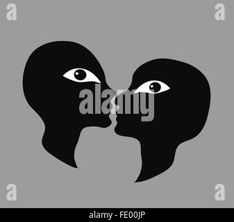 A couple about to kiss, looking at the viewer - Stock Image