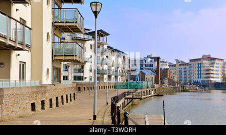 Modern purpose build apartments and flats overlooking Bristol floating harbour near city centre, England - Stock Image