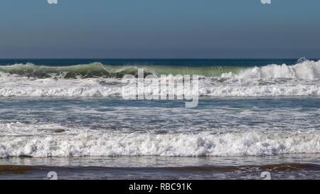 Atlantic Ocean waves breaking on sand beach in Agadir, Morocco, Africa - Stock Image