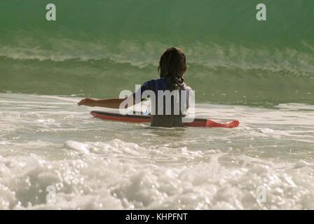 Boy bodysurfing on the Sunshine Coast, Queensland, Australia - Stock Image