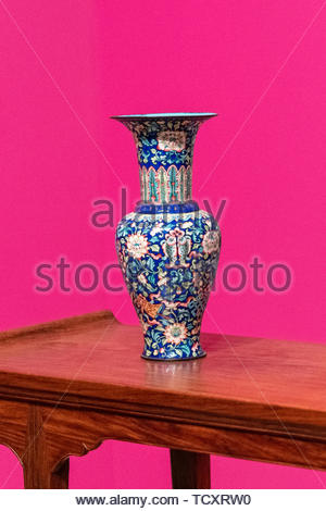 Beautiful multicolor vintage Chinese vase seen in the 'Gods in my House' exhibit at the Royal Ontario Museum (ROM). The object is over a wood table. T - Stock Image