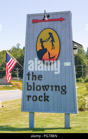BLOWING ROCK, NC, USA,-23 AUG 2018: A sign advertising the blowing rock attraction, for which the town is named. - Stock Image