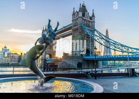 Girl with dolphin with Tower Bridge, River Thames, London. - Stock Image