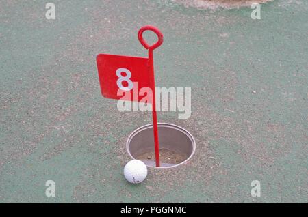 Mini Golf Putting Hole Ball - Stock Image