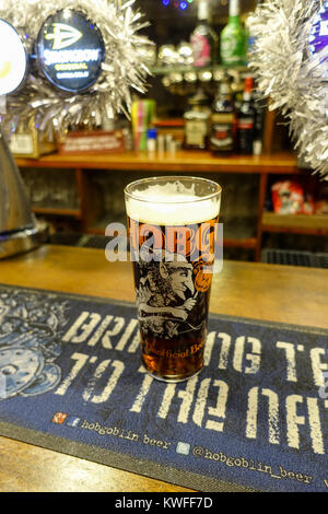Pint of Hobgoblin on the Bar at Christmas - Stock Image