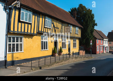 View of Bildeston High Street including the yellow half timbered Crown public house, Babergh district, Suffolk, England, UK. - Stock Image
