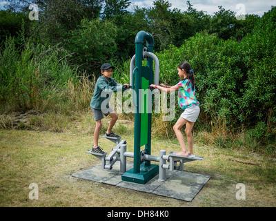 Children use step machine in public park New Zealand - Stock Image