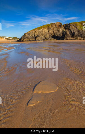 Sand patterns on Perranporth beach, North Cornwall, UK, one looks like a huge footprint. - Stock Image
