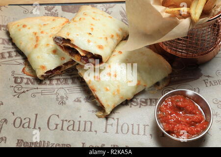 A set of tortilla sandwiches with fries - Stock Image