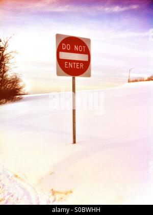 Do not enter sign in front of snow field - Stock Image