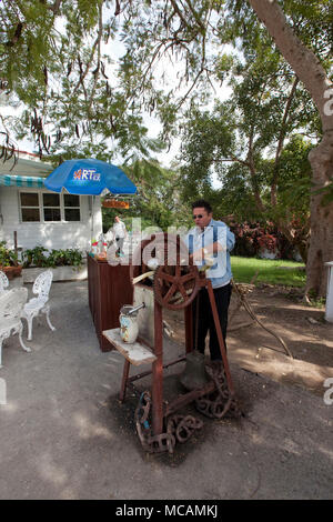 Making sugar cane drinks at the restaurant at the Ernest Hemingway home in Havana, Cuba - Stock Image