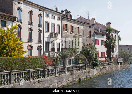 The River Meschio Is Forced Into Its Narrow Bed By The Historic Town Of Vittorio Veneto - Stock Image