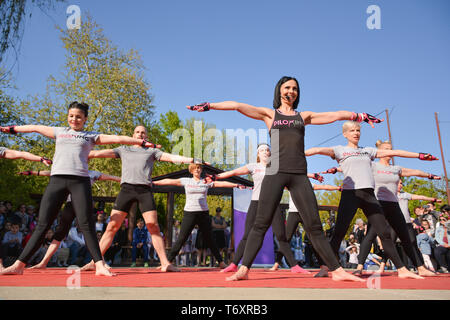 Nis, Serbia - April 20, 2019 Large group of happy young people with instructor training Piloxing sport on sunny spring day - Stock Image