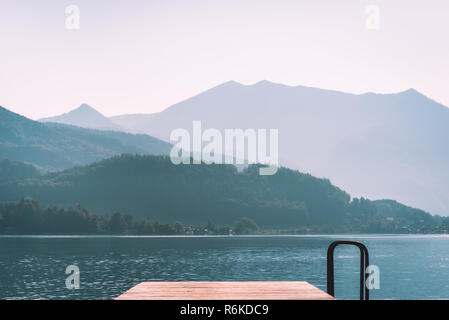 Wooden pier on Wolfgangsee at early morning, Austria - Stock Image