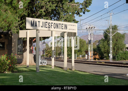The Matjiesfontein train platform, at the village's station, with focus on the name sign.  Matjiesfontein - South Africa, - Stock Image