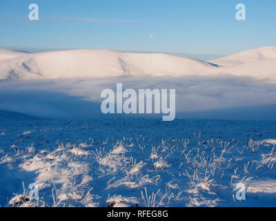 Cloud inversion from a snowy Nether Oliver Dod, near Tweedsmuir, Southern Uplands, Scotland - Stock Image