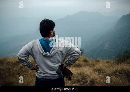 Male keeps his hand and relaxing and looking for his next location for travel - Stock Image