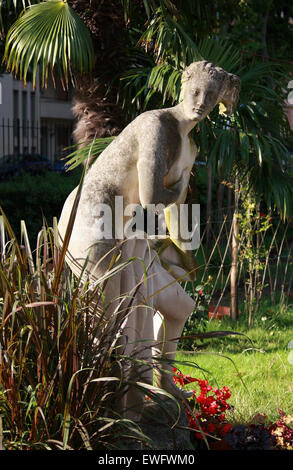 Statue of a Nude Woman in the Gardens of Palais Carnoles, Menton, Cote D'Azure, South of France. - Stock Image