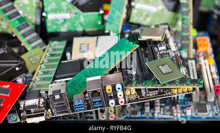 Computer and laptop cards. Mainboards, chips and memories. Pile of new obsolete PC parts. CPU, PCB, RAM, DIMM, connectors, slots, capacitors. E-waste. - Stock Image