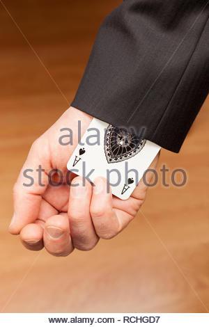 Ace card hidden up jacket sleeve - Stock Image