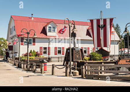 The Sons of Norway Hall Fedrelandet Lodge and Viking ship in Bojer Wikan Fishermens Memorial Park in Petersburg, Mitkof Island, Alaska. Petersburg settled by Norwegian immigrant Peter Buschmann is known as Little Norway due to the high percentage of people of Scandinavian origin. - Stock Image