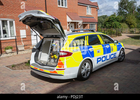 Empty police estate dog transport car with its boot open displaying extra equipment for the dog handler - Stock Image