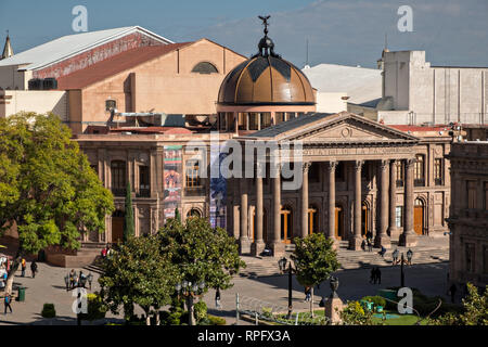 Elevated view of the Teatro de la Paz or Theater of Peace in the historic center on the Plaza del Carmen in the state capital of San Luis Potosi, Mexico. The building was built by the architect Jose Noriega with French influences and neoclassical style, with its facade in pink quarry in 1894. - Stock Image